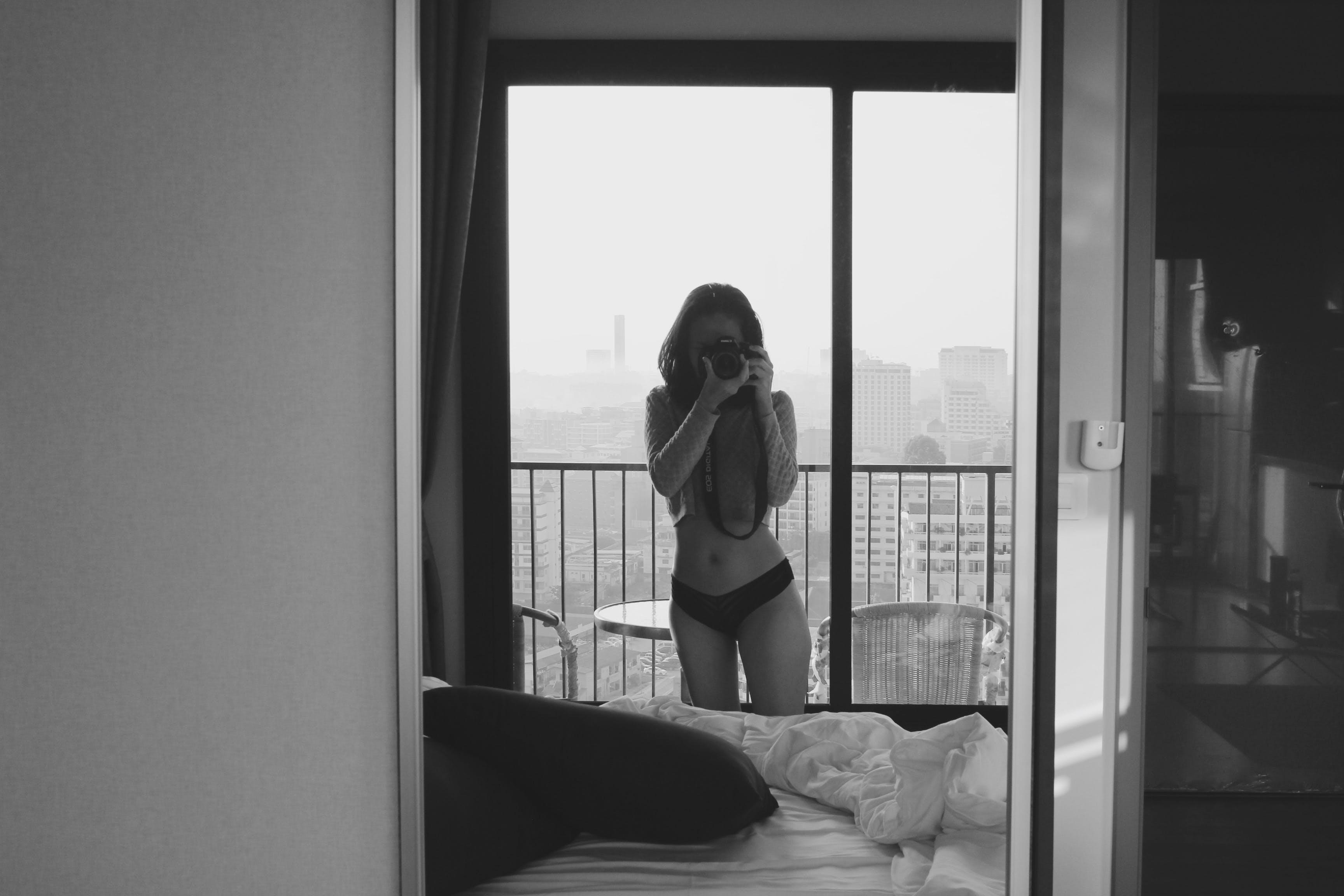 Woman Taking Photo of Herself on Mirror