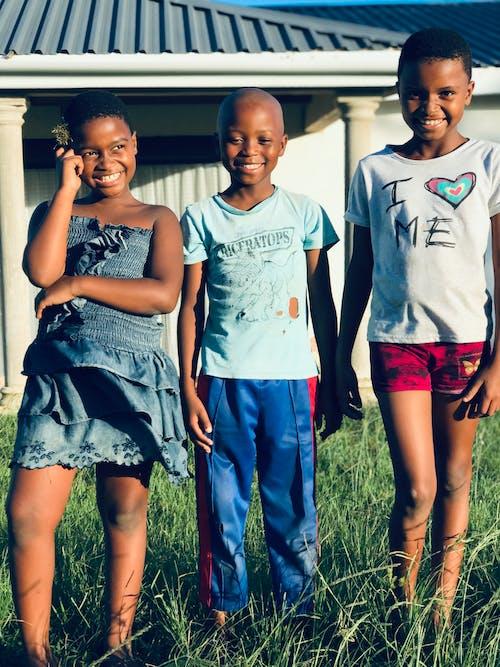 Happy smiling black children in backyard