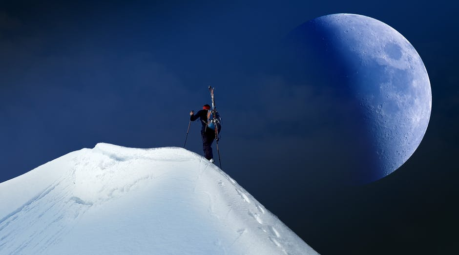 Man Trekking on Mountain Covered With Snow