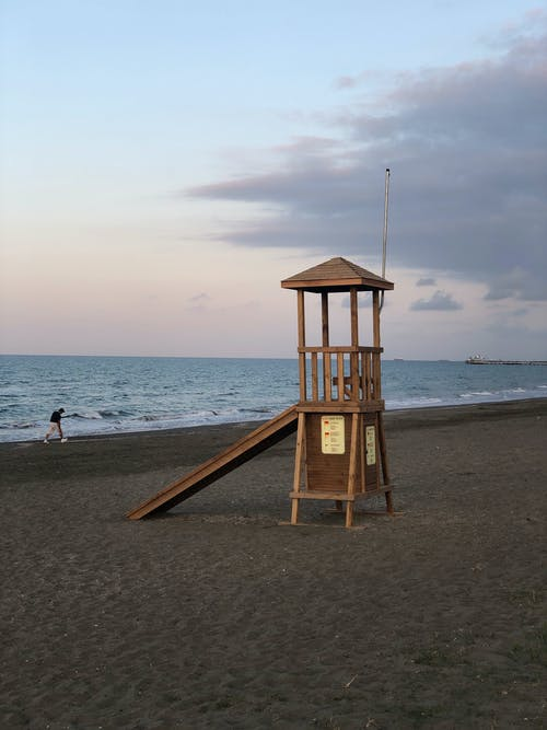 Cozy small wooden lifeguard station located on empty sandy beach in dusk