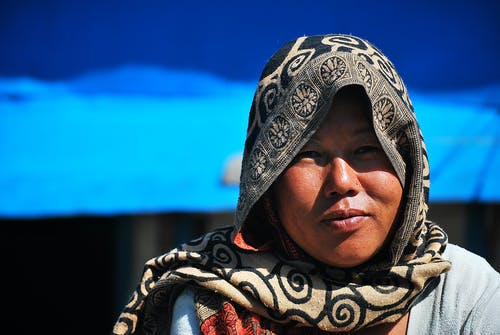 Adult Asian woman looking at camera in village