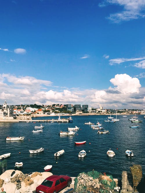 White Boat on Sea Under Blue Sky