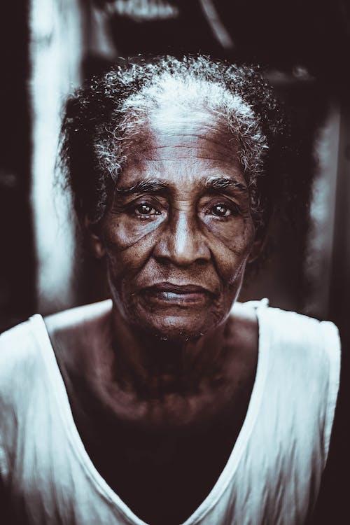 Pensive senior black woman looking at camera