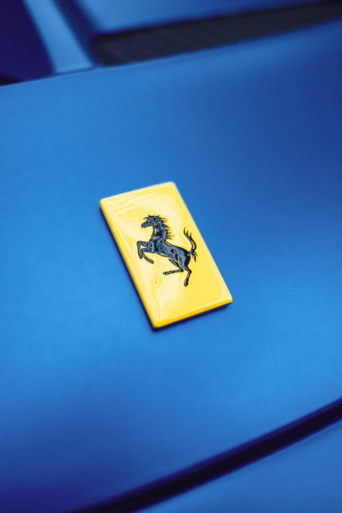 Yellow badge on blue sports car