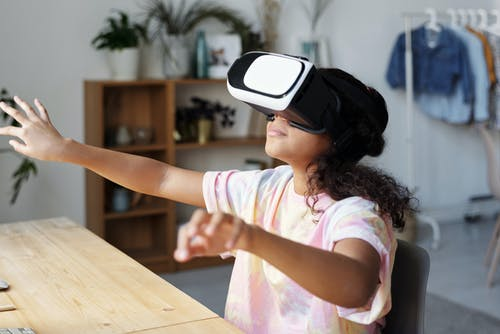 Girl in White and Pink Shirt Wearing White Vr Goggles