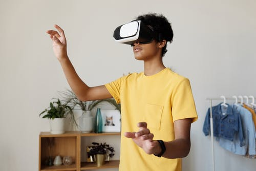 Boy in Yellow Crew Neck T-shirt Wearing White and Black Vr Goggles