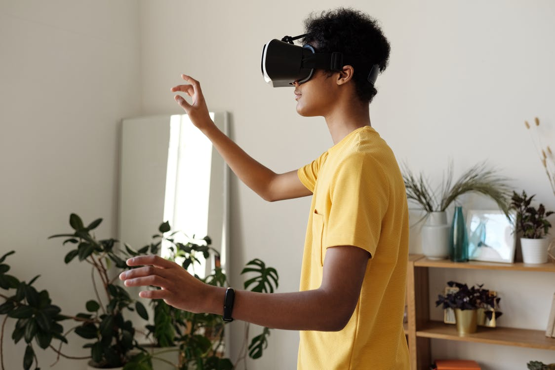 Boy in Yellow T-shirt Wearing Vr Headset