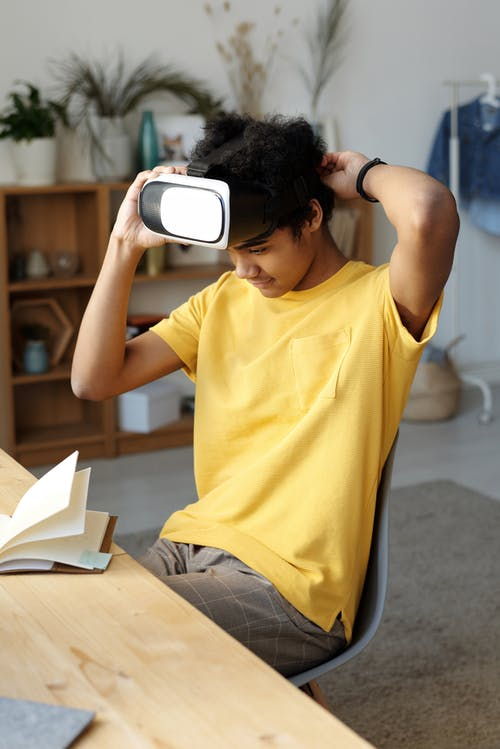 Man in Yellow Crew Neck T-shirt While Wearing Vr Headset