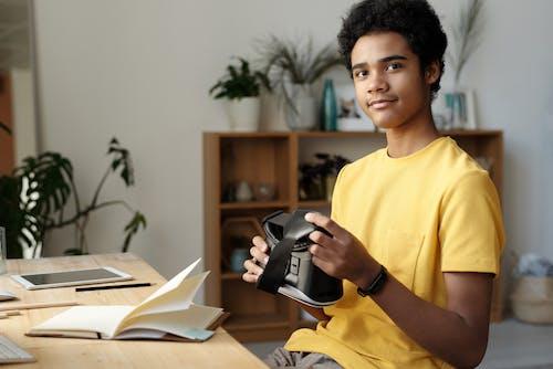 Photo of Boy Holding Vr Headset