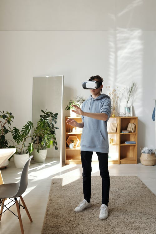 Photo of Boy Standing While Using Vr Headset