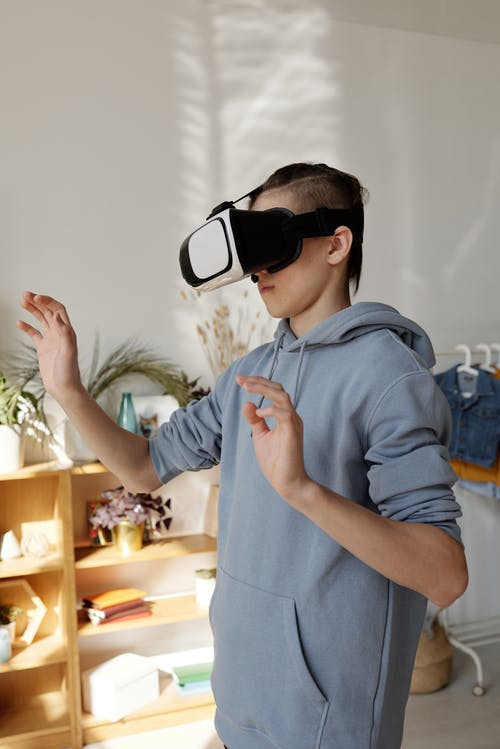 Boy Wearing Gray Hoodie and Vr Headset