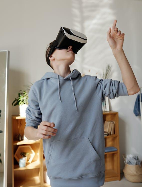 Boy in Gray Hoodie Wearing Vr Headset