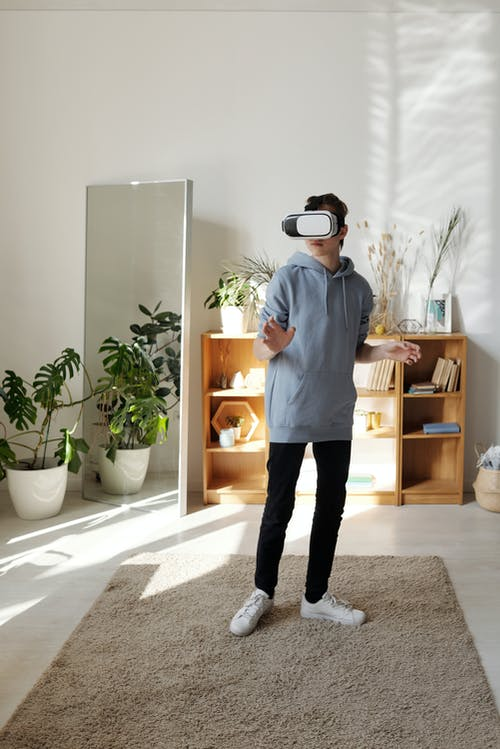 Boy Standing While Using Vr Headset