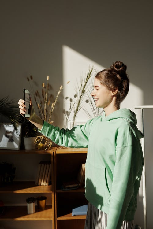Photo of Girl Taking Photo Using Smartphone