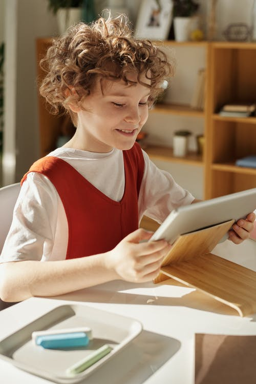 Photo of Child Using Tablet Computer