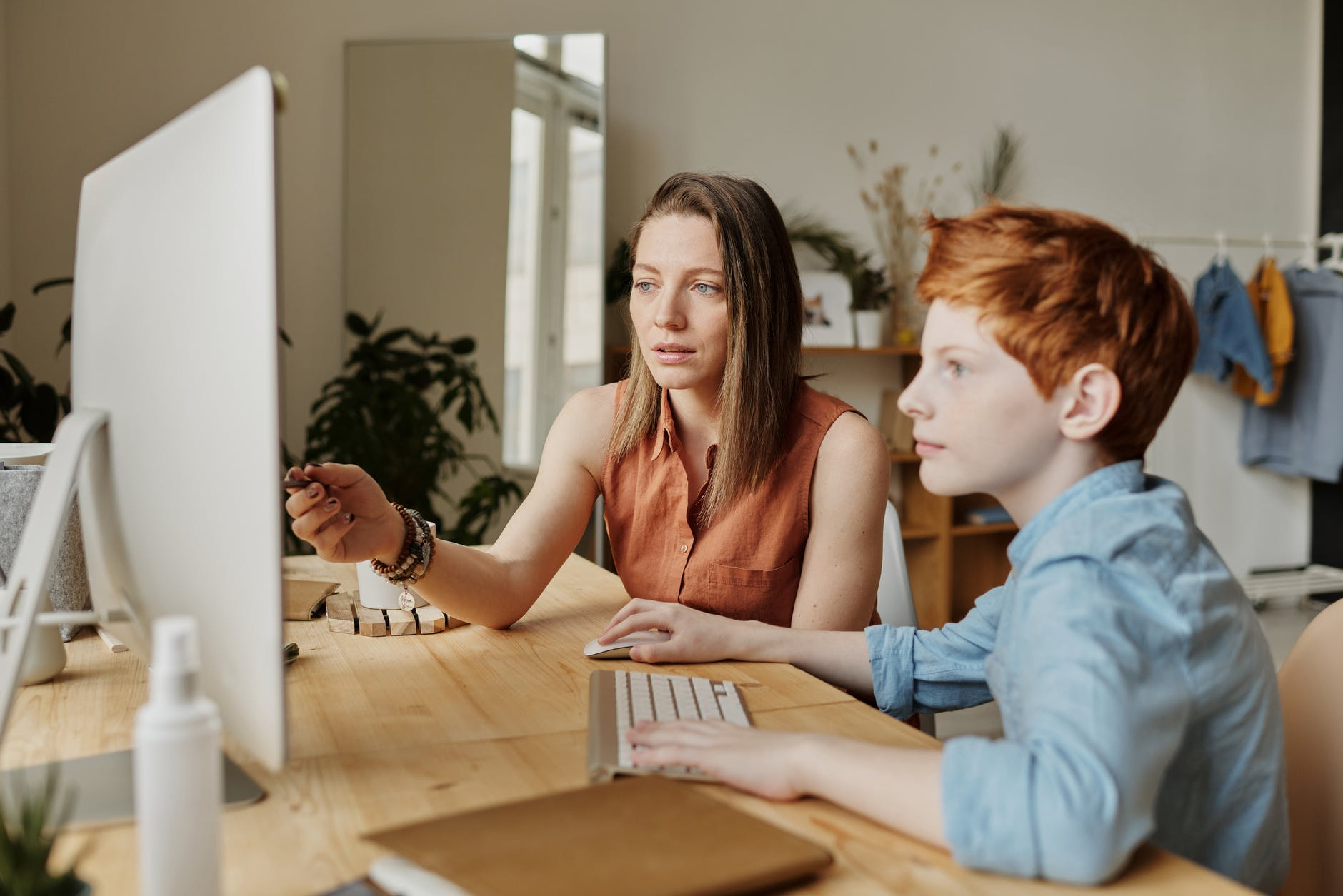 Mother helping Son on a computer