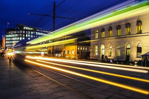 Illuminated exterior of modern city street