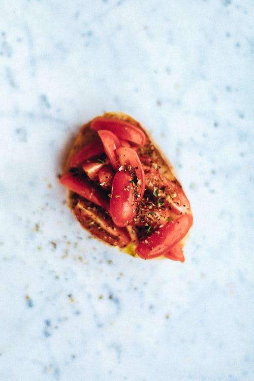 Red Tomato on White Textile