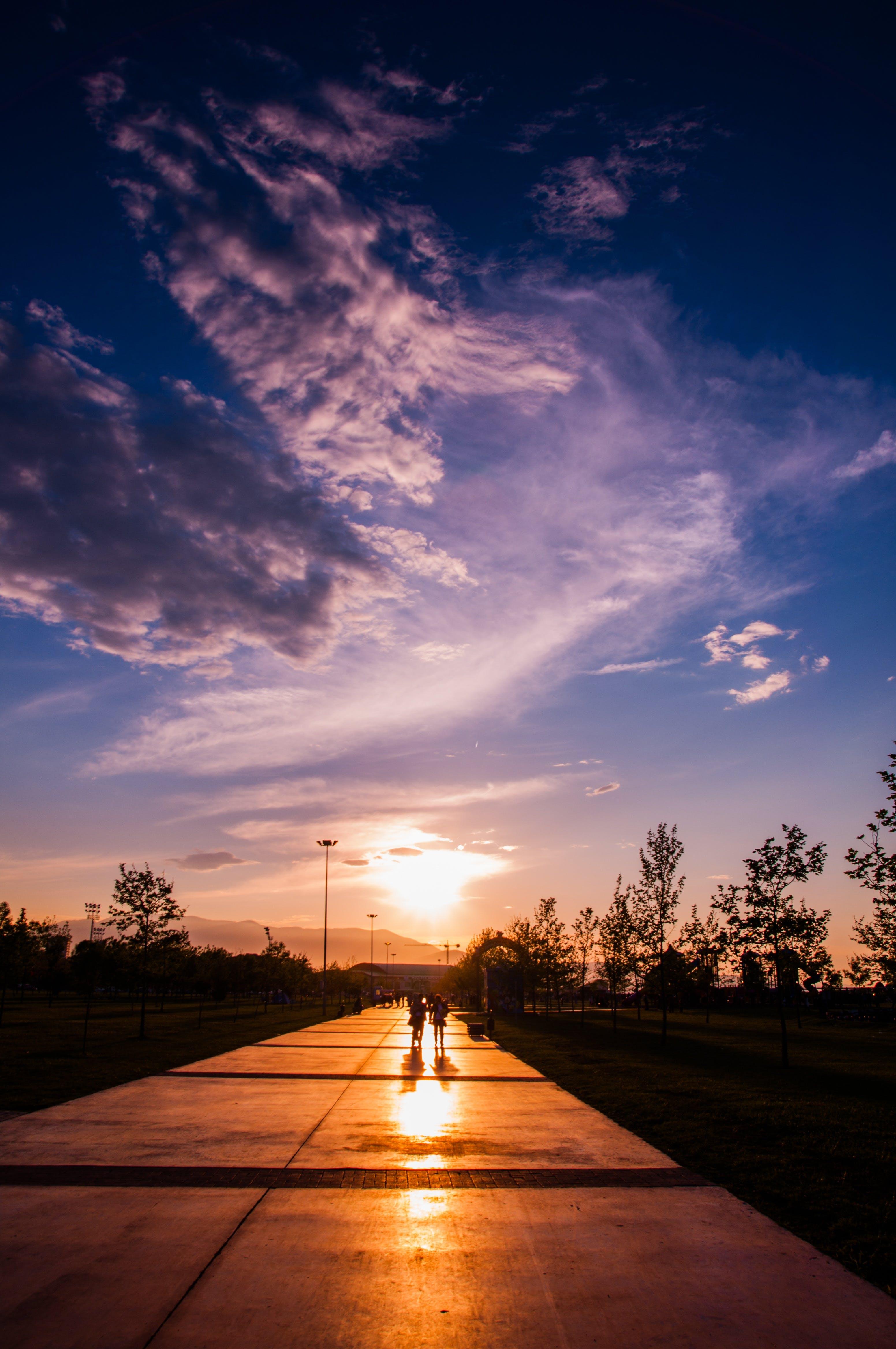 Two Person Walking on Concrete Pavement