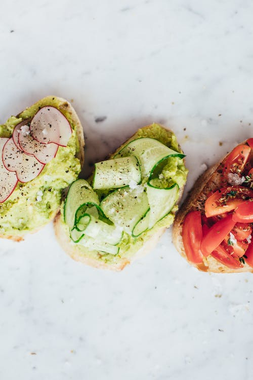 Delicious healthy bruschetta with tomatoes radish cucumber and avocado