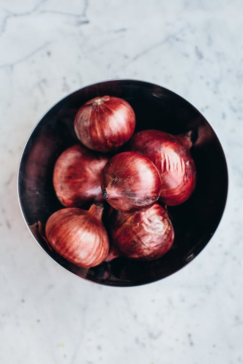Bowl with raw ripe aromatic red onions