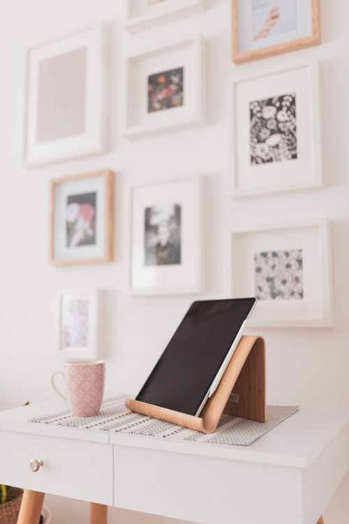 Modern tablet on stand on cozy vanity table