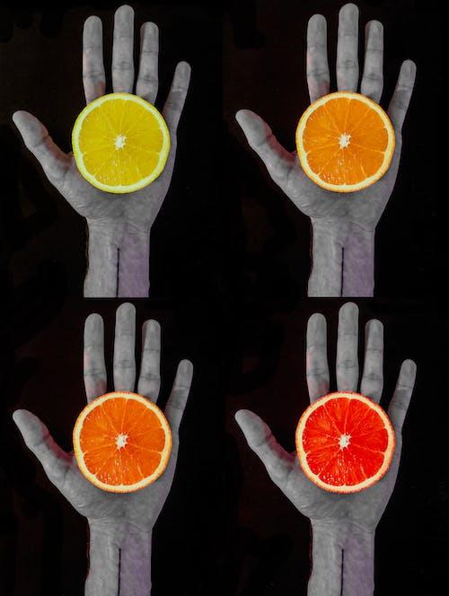 Kostenloses Stock Foto zu farbe, frucht, hand, kontrast
