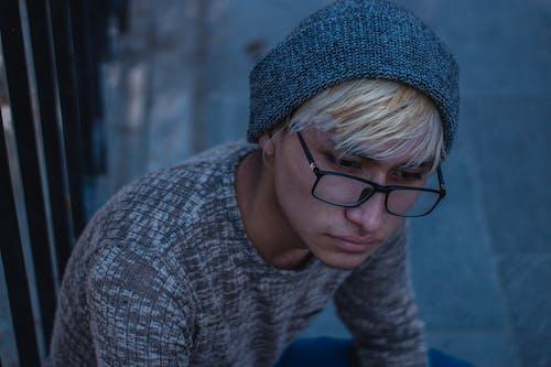 Woman in Gray Knit Sweater Wearing Black Framed Eyeglasses