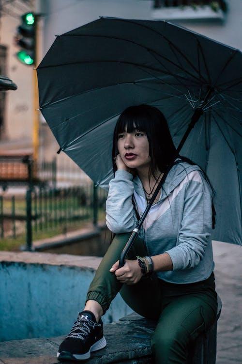 Woman in Gray Zip Up Jacket Holding Umbrella