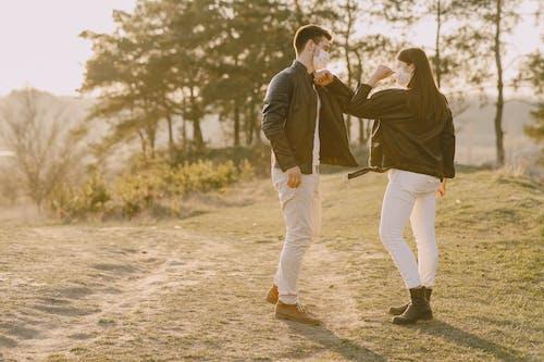 Photo of Couple Doing Elbow Bump