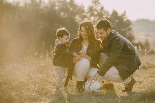 Photo of Family on Grass Field