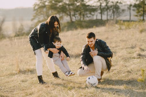 Photo of Family Playing With Soccer Ball