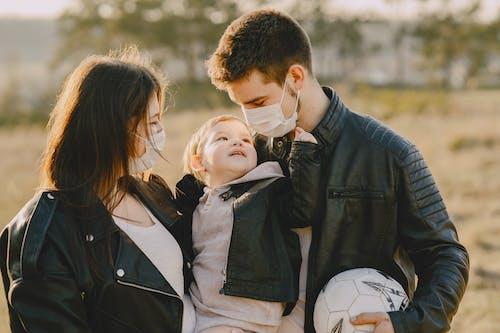 Photo of Family Wearing Black Leather Jacket