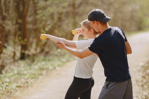 Determine couple in sportswear during workout in park