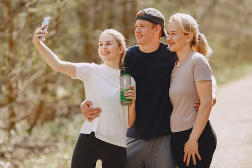 Photo of Man and Women Taking Selfie