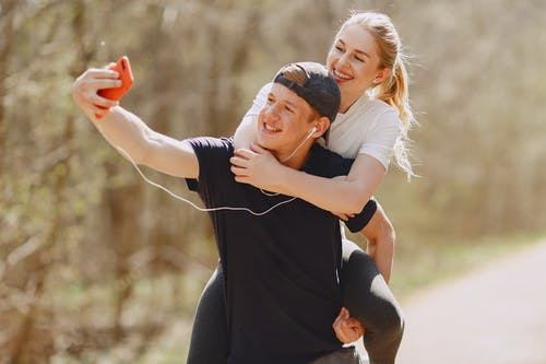 Photo of Couple Taking Selfie