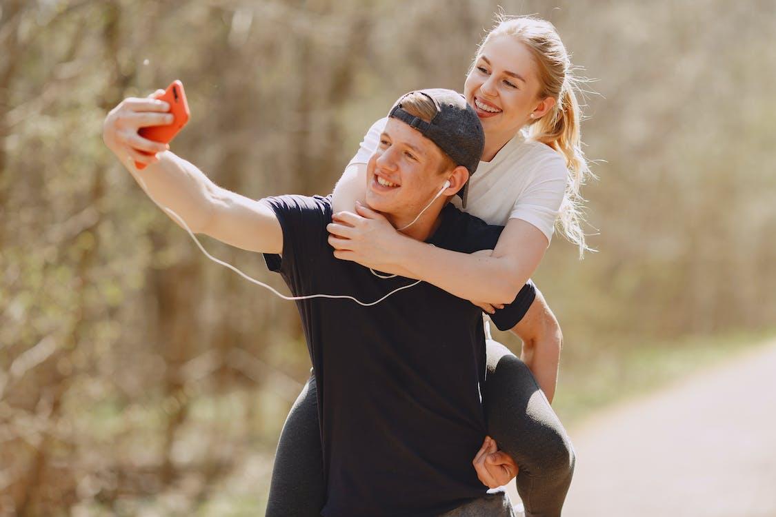 Photo of Couple Taking Selfie