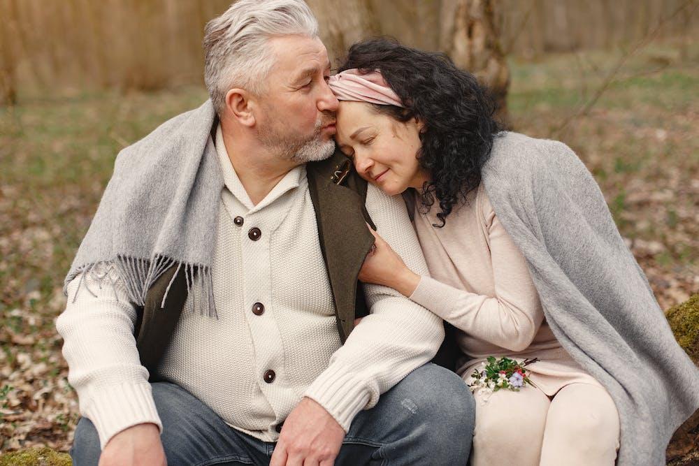 Happy senior couple hugging in the park. | Photo: Pexels