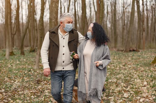 Man and Woman Standing on Forest