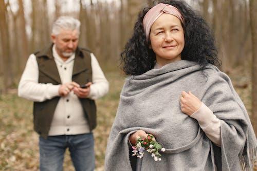 Happy elderly couple in love walking in park