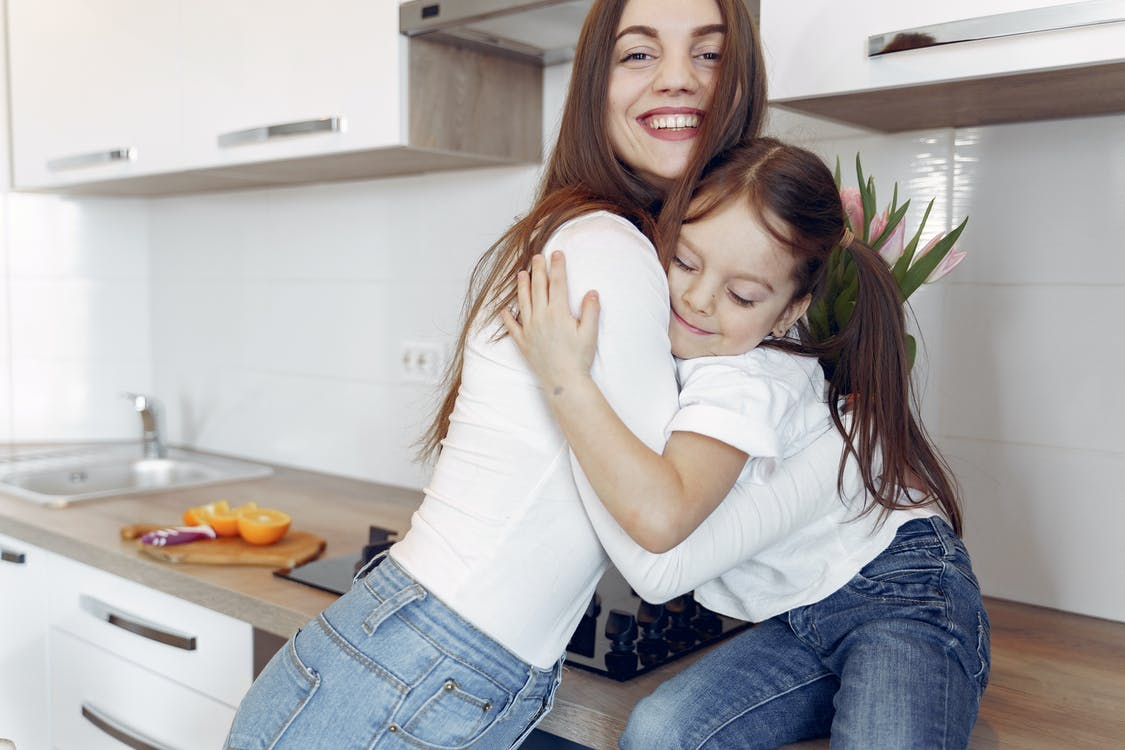 Photo of Mom and Daughter Hugging Each Other