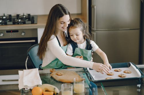 Photo of Woman and Child Baking Cookies