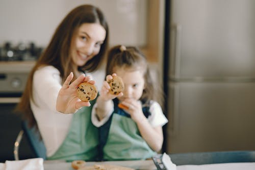 Shallow Focus Photo of Person Holding Cookies