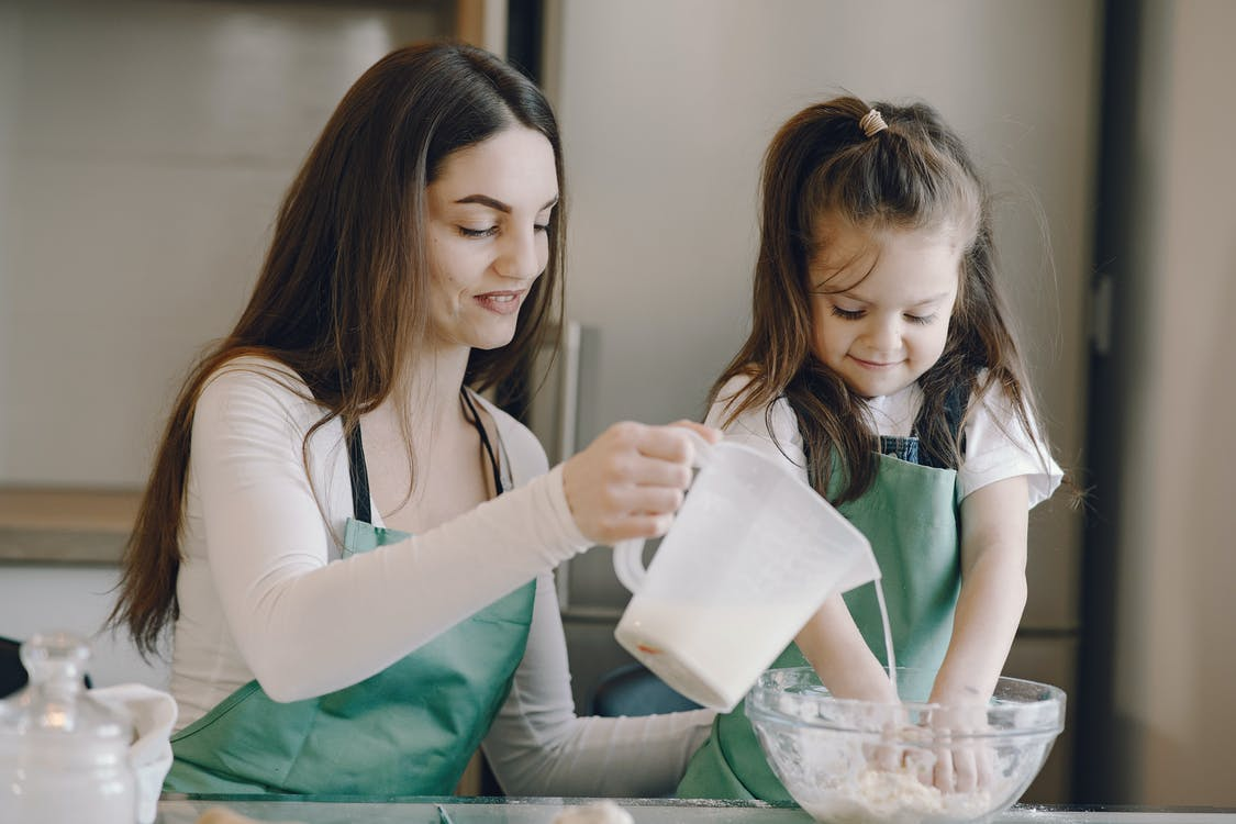 Photo of Woman and Child Baking