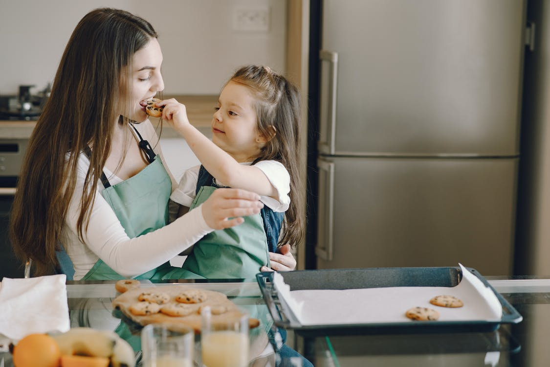Photo of Woman Eating Cookie