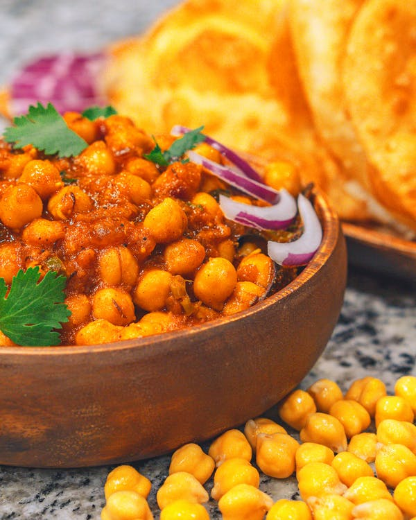 Bowl of delicious stewed chickpeas with onion