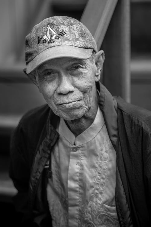 Monochrome Photo of Man Wearing Cap