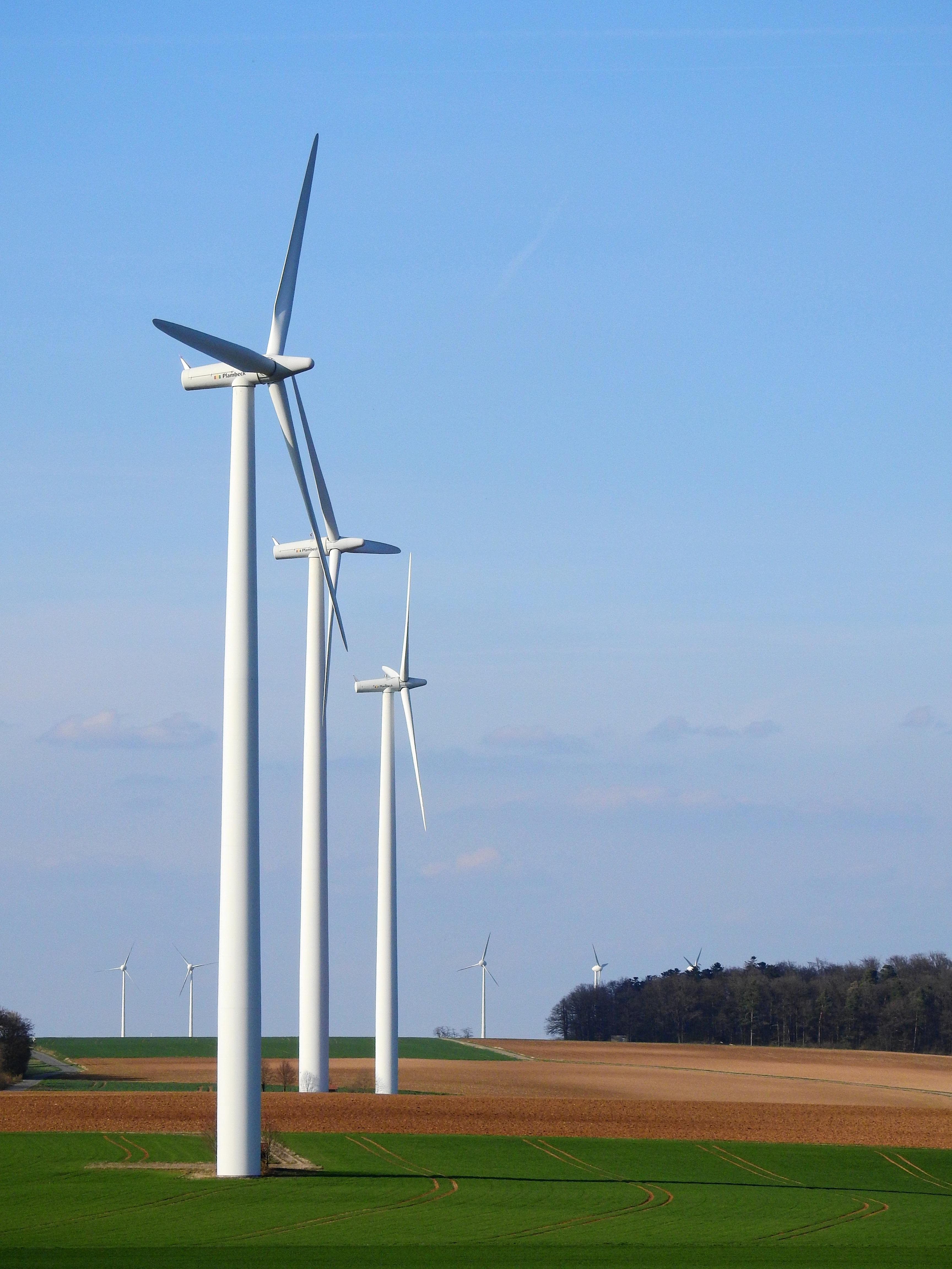 Photography of Three White Windmills