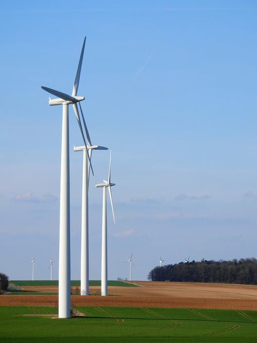 Photography of Three White Windmills