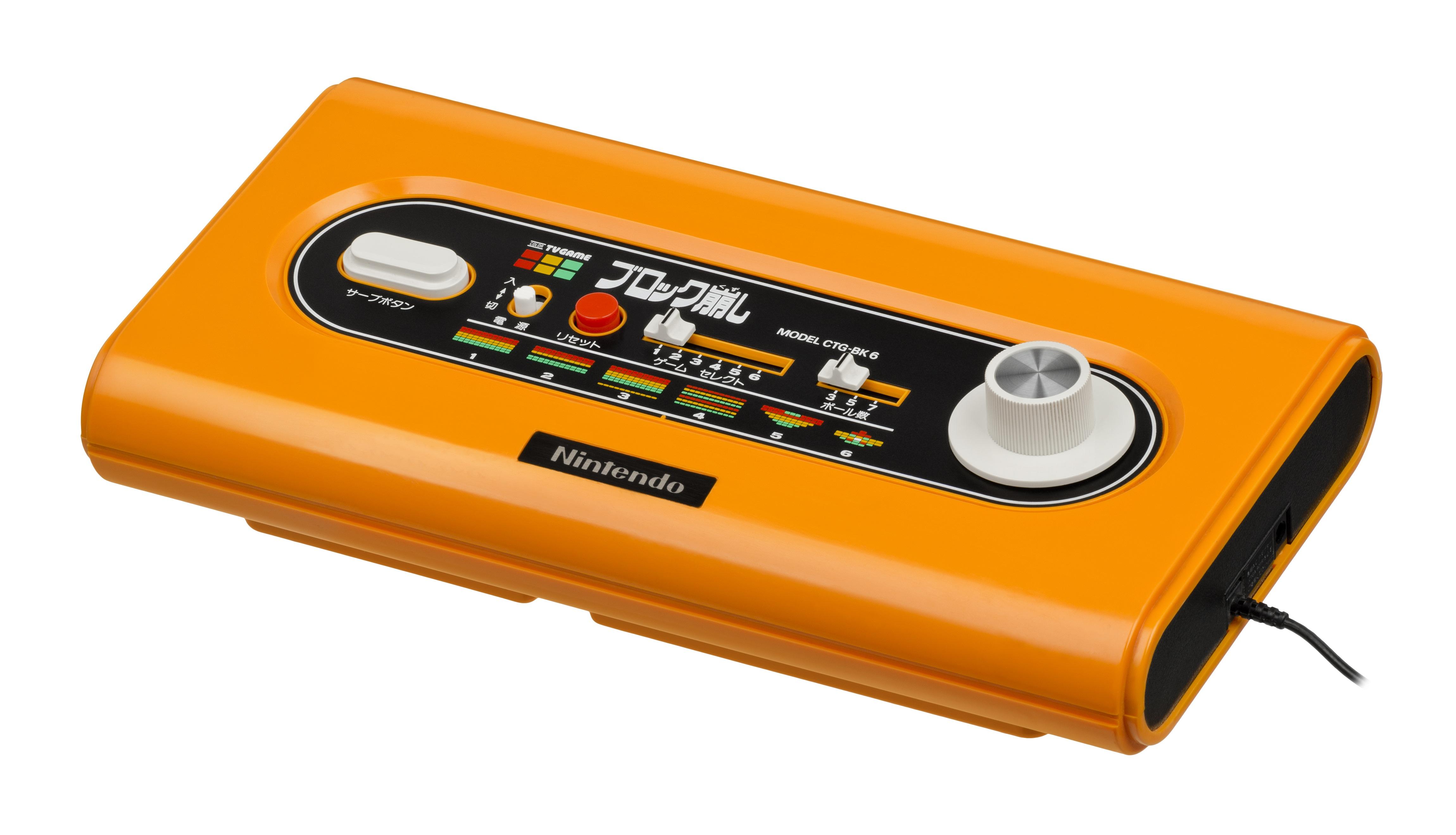 Orange and Black Nintendo Game Console